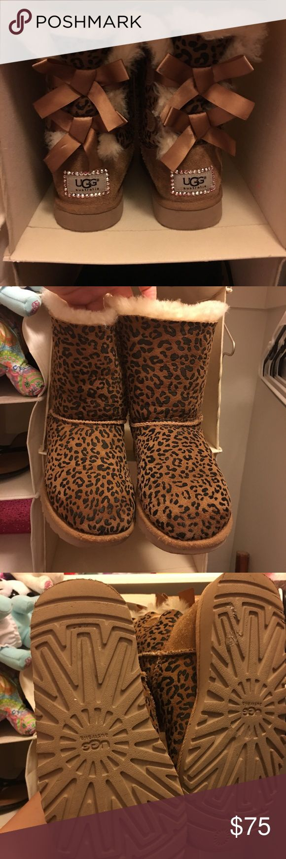 Girls ugg boots cheetah print Girls sz 2 ugg cheetah print Bailey boots w/bows has genuine Swarovski crystals embellishments on the back. UGG Shoes Ankle Boots & Booties
