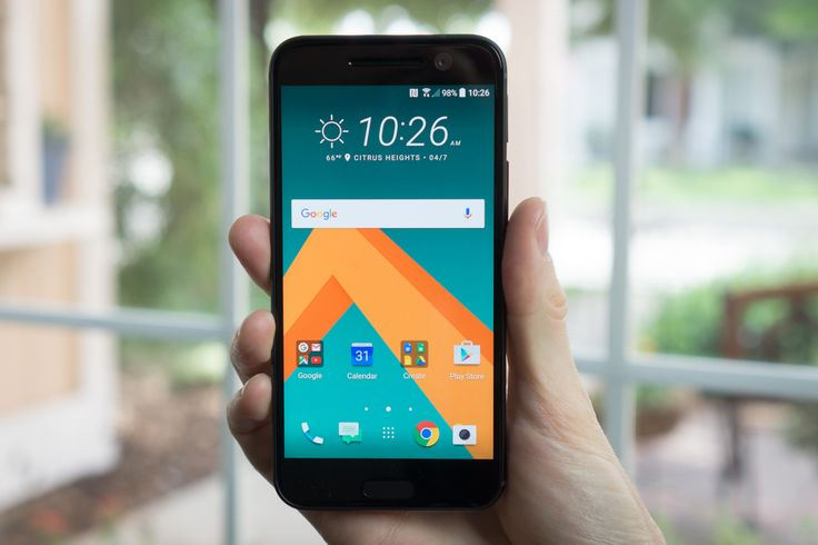 Black HTC smartphone in a man's hand image. Place your Android app screenshot inside this image with a few easy clicks on PicApp.net.