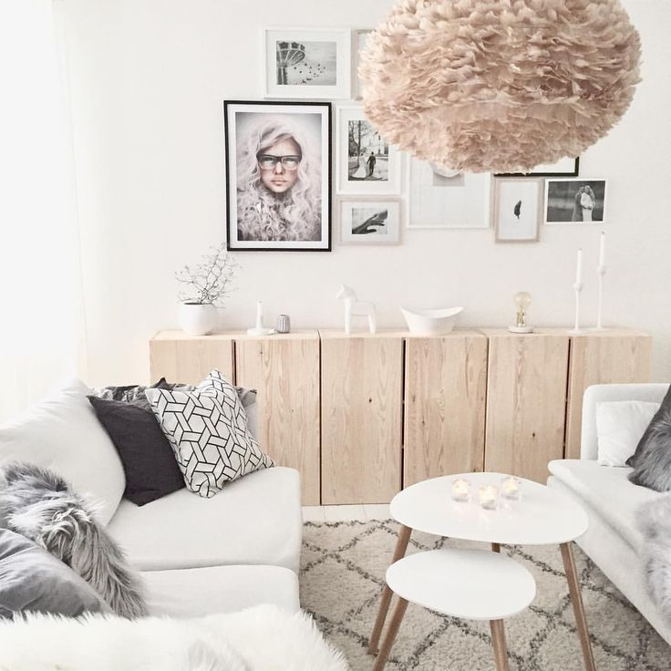 Soft and calm livingroom with white styling combined with wood and framed poster from printler.com, motif by LisaLove Bäckman. Interior design by mz.interior at instagram.