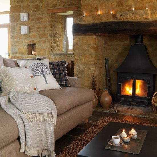 love the stone walls, the fireplace and the beam over the fireplace