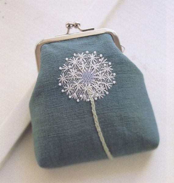 I'm not really a coin purse carrier, but I'm obsessed with this adorable embroidery