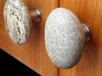 Cabinet knobs made from real beach stones, from Sea Stones