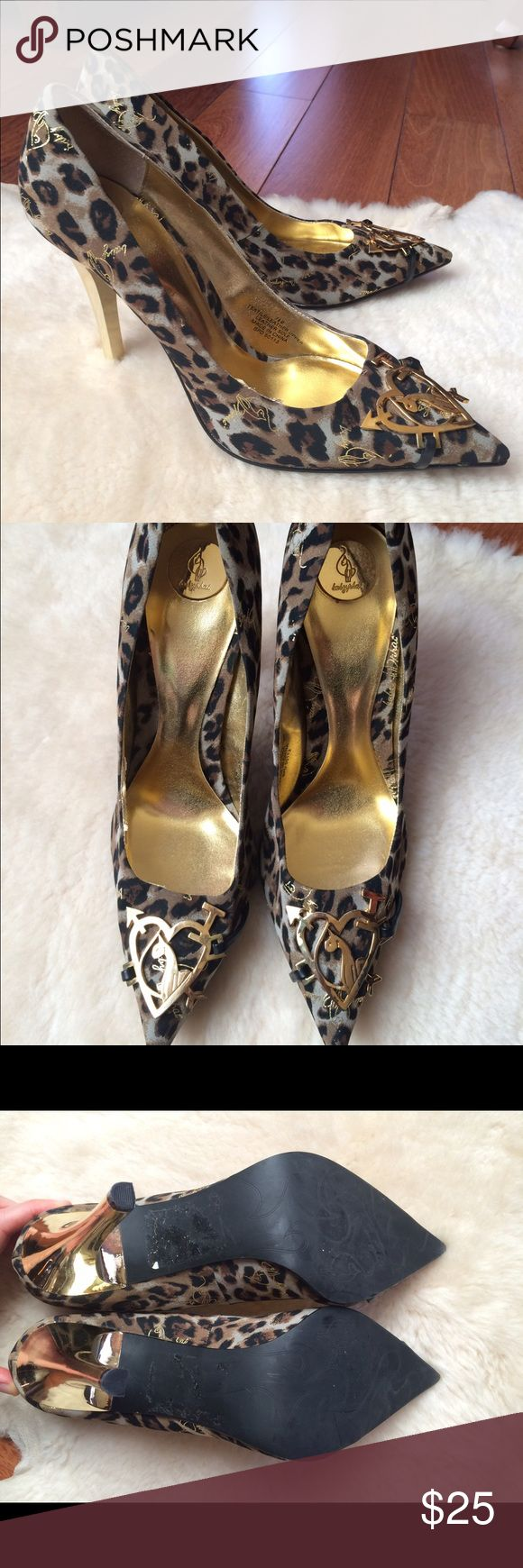 Baby Phat Leopard Gold Metal Heels Size 7.5 Great condition, only worn a handful of times. Gold is plastic, emblems are metal. Size 7.5 Baby Phat Shoes Heels