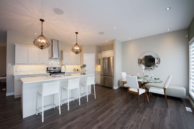 Neutral Galley/L-Shaped Showhome Kitchen and Open Concept Dining Room