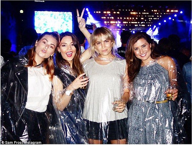 High and dry: The night before, Sam Frost donned a plastic poncho as she enjoyed a rain-so...