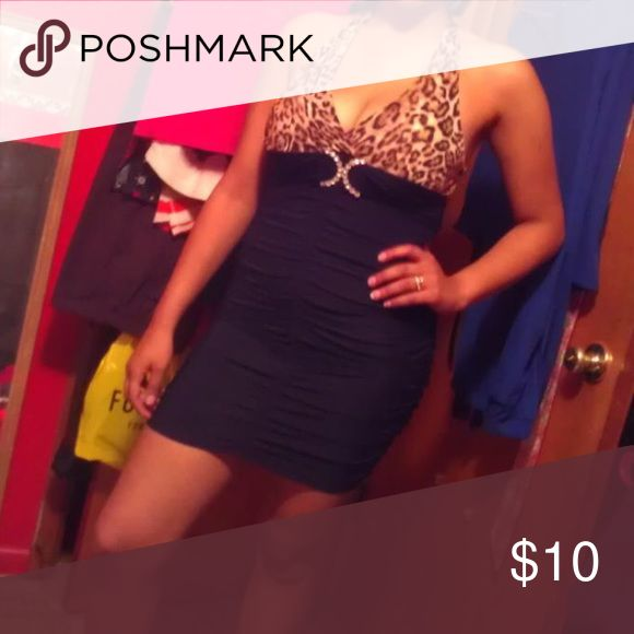 Cheetah print dress Gorgeous cheetah print dress ! Love it !    Great condition no tears no rips no stains. Only worn about 2-3 times and looks great for a night out. Dress it with some dangling silver earrings or hoop earrings and a nice pair of heels or even flats !  Flawless ! Size is large but it's tight fitting easy pickins Dresses Strapless