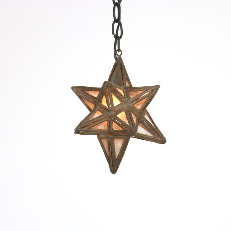A lovely, warm Moroccan Metal and Glass Star Lantern, circa 1930; height: 8 in.20.25 cm., diameter: 8 in. 20.25 cm. link: http://www.gardencourtantiques.com/shop/moroccan-metal-and-glass-star-lantern-circa-1930/ #star #starpendant #starchandelier #pendant #chandelier #seasidestyle #napastyle #table #vintage #homedecor #designblog #styleblogger #styleblog #classic #sanFrancisco #interiors #interiordesignblog #interiordesignideas #antiqueshop #antiques #weathered #lightdesign #morrocan