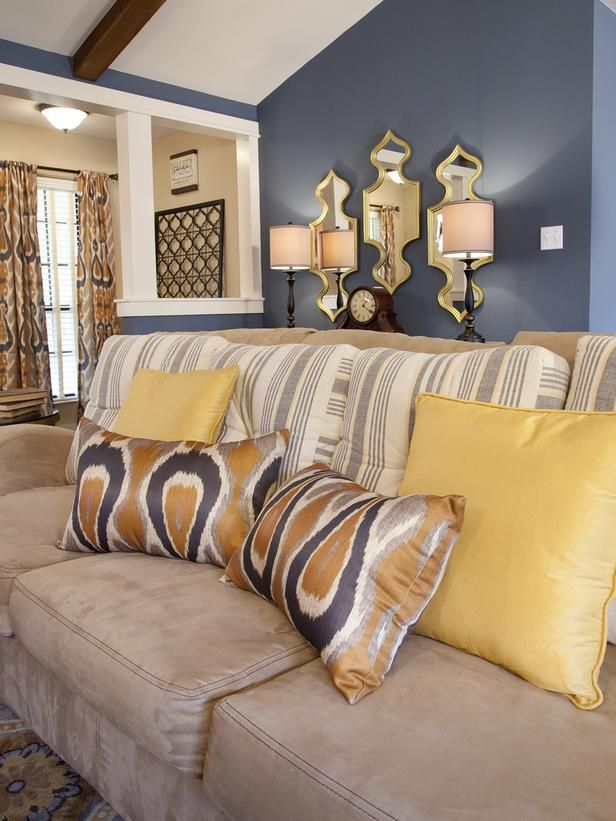 Living Room Sofa With Yellow Acent Pillows And Mirror