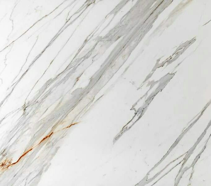 Macrostone International. Stone: Calacatta Marble. A beautiful White marble with a soft grey and subtle bronze vein. Imagine what a show piece this could be in your home. Up on the wall as a Splash back, on a polished kitchen bench top or on the floors as sold marble titles. The choices are endless.