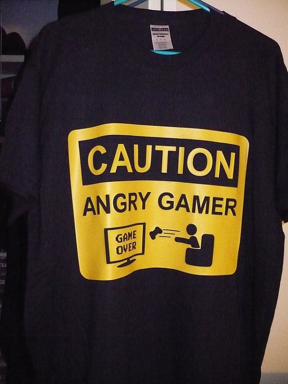 This is why Ty doesn't like it when I play with his xBox: I throw things at it. Angry Gamer Tshirt Caution Sign by vinyledgedesigns on Etsy, $19.99