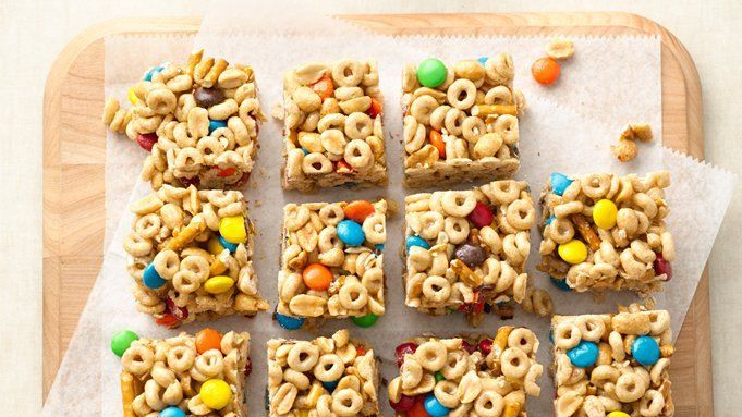 M&M's™ chocolate candies  and salty peanuts and pretzels make these no-bake cereal bars the perfect snack.