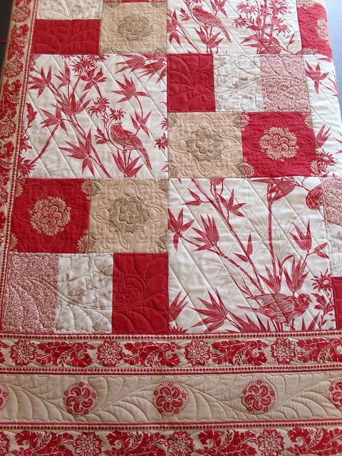 Simple pattern ...looks like layer cakes and charm square in Moda, the material makes this quilt. Lovely border