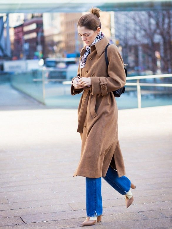 A striped silk scarf is worn with a long camel coat, blue jeans and heeled boots: