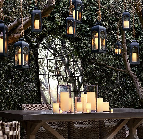 remote control indoor/outdoor flameless pillar candles- I must get them! Hanging candles with remote!
