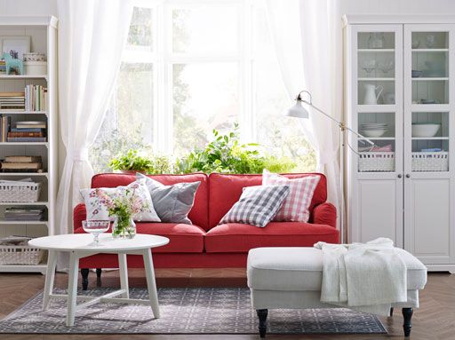 A White Living Room With Red STOCKSUND Sofa LIATORP Cabinet And Bookcase In