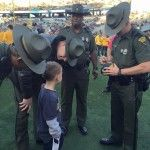 Young Boy Asks WV State Troopers For Their Autographs