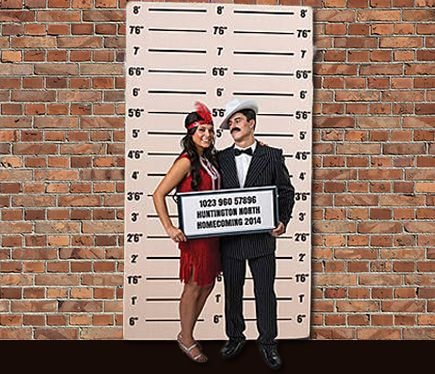 Photo booth mug shot wall for your 1920s Speakeasy party. Plan your next party at www.sparklerparties.com