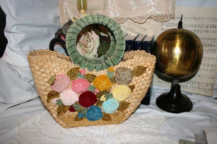 1950s Straw Satchel//Velvet Flowers and Wrapped Velvet Handles//Gold Thread Ribbon Trim//Vintage Straw Satchel by TresorsJeAmour on Etsy https://www.etsy.com/listing/267983357/1950s-straw-satchelvelvet-flowers-and