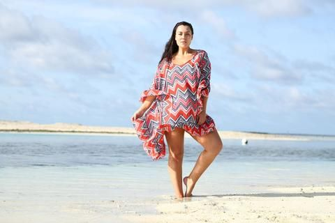 This carefree summer time Zig Zag Coral and Navy Full Moon Kaftan from jamjam Clothing features zigzags of playful navy, red and pink hues, designed to be free flowing and not restrictive. Adorned with beautiful patterns, full length and a flowing line cut hem, refreshing style with a wide v-cut shaped neckline. This Zig Zag Coral and Navy Full Moon Kaftan is the perfect attire for spring or summer outings.