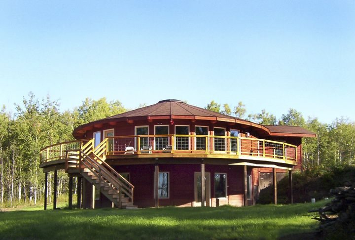 2 story yurt style home with deck yurt pinterest for Cost to build a 2 story house