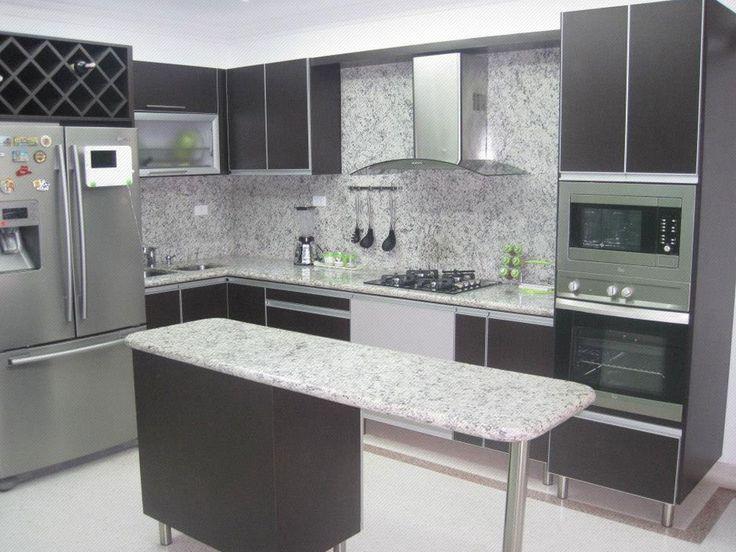 Cocina Integral enchapada en formica color wengue con marco y manija en aluminio y mesón y pared en granito color jaspe. Imagen en miniatura, dar click para ver en tamaño completo.