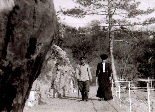 Tsar Nicholas II and Tsarina Alexandra walking in Livadia.