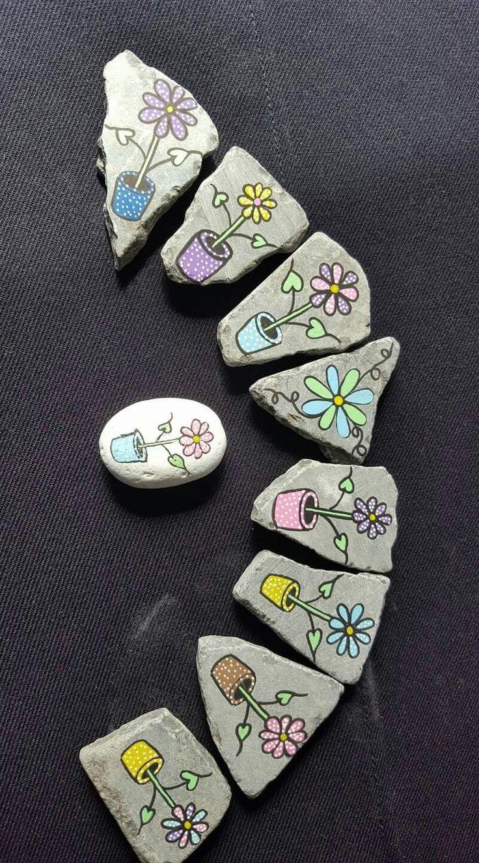Flowers in pots on rocks