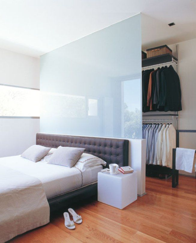 adorable zoning of the room to optimally use space with white ;bedding set as well tempered glass partition closet plus wooden floor