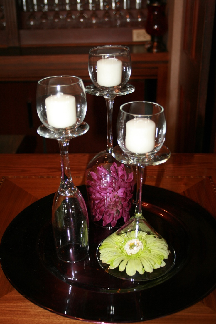Simple table decoration idea with wine glasses votives for Wine glass table decorations