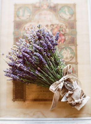 The brides lavender bouquet was dressed with vintage velvet ribbon Photos byLittle White Dress Flowers byMindy Rice Floral Design - Project Wedding