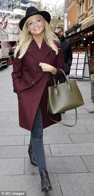 Wearing a burgundy-coloured overcoat, the former singer looked classy and cool as she navi...