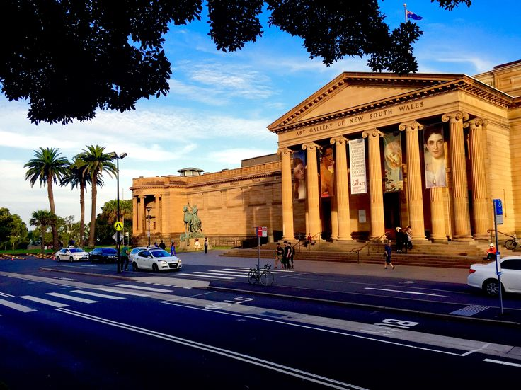 Golden afternoon sunshine on Roman looking art gallery & some lovely date palms in Sydney.