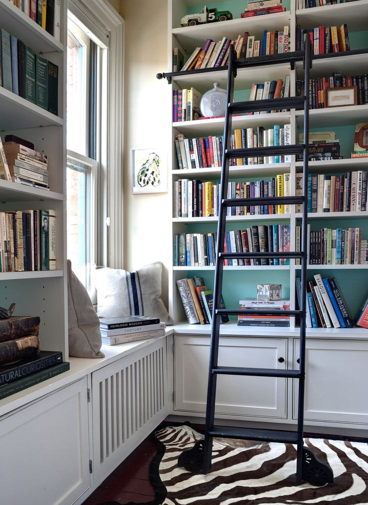 Library With White Built In Shelving Pop Of Color And A
