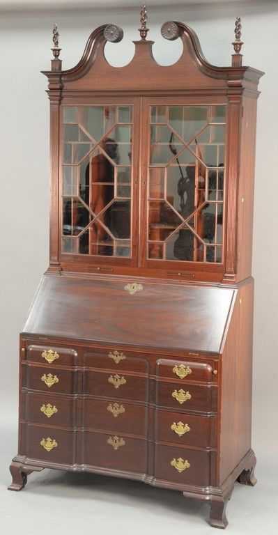 Margolis mahogany secretary desk in two parts, upper portion with broken arch top over two glazed doors opening to reveal compartments set on lower portion with slant lid over four block front drawers, all set on ogee feet ~Realized Price $3,600.00