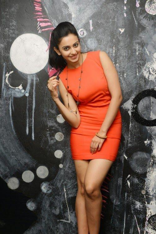 RAKUL PREET SINGH Photos Orange Dress - Rakul Preet Singh