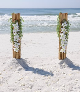 Bamboo columns decorated with flowers. The ash scatterer will stand between them.