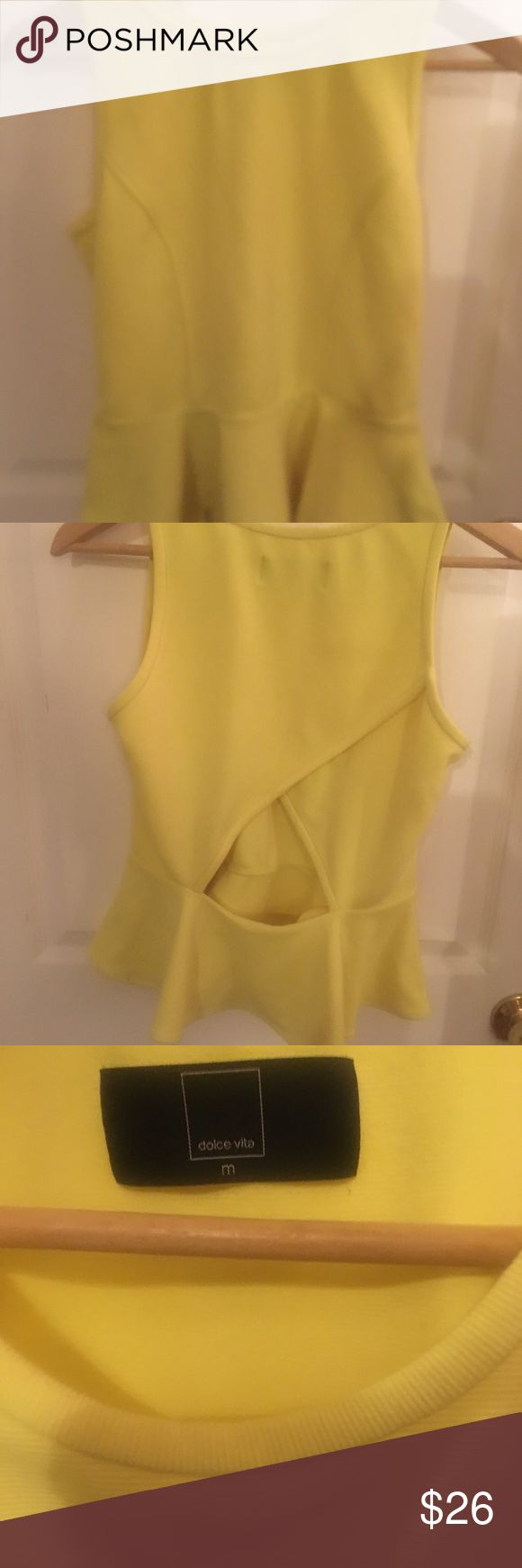 Yellow peplum top with back cut out Cute peplum top with interesting cut out on the back. Runs small for a medium- was a 2/4 when I wore this top. Dolce Vita Tops Tank Tops