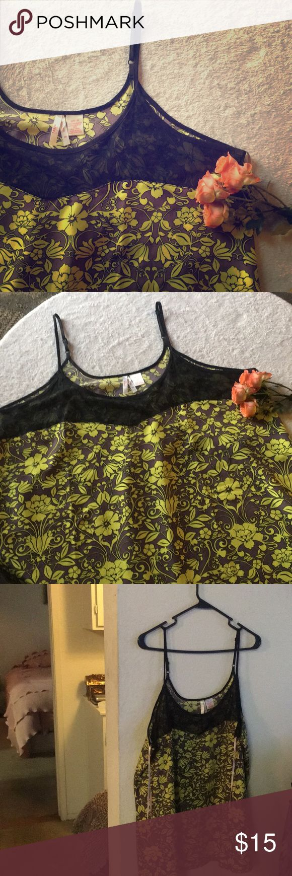 """NWOT Sexy Floral Print + Mesh Camisole Two left .. 1X & 2X. Mixing neutrals with a pop of shocking neon has been fashionable since the early 1950's... a style envisioned and executed by Christian Dior... originally known as the """"shocking pink"""" trend. In the later half of 2017 and again for spring and summer 2018 """"neon pops"""" have been sexied up and cooled down. I love the black mesh on this shirt because it adds an element of mysterious fashionista. Let me know if you have any questions True…"""