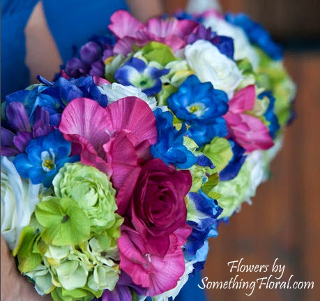 Vibrantly hued bridesmaid bouquets featuring very realistic, silk/artificial white and hot pink roses, green hydrangea, green ranunculus, pink gladiolus, blue delphinium, and purple cosmos. By Something Floral / Something Spectacular. #wedding #flowers #bouquet #bridal #bridesmaid #realistic #artificial #silk