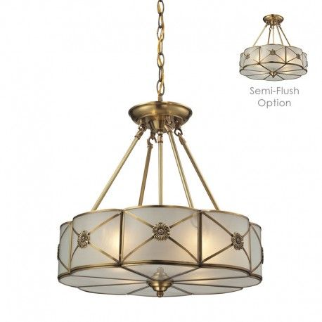 floral medallions stud the outside of this drumshaped fourlight pendant segmented with steel for a stately traditional feel