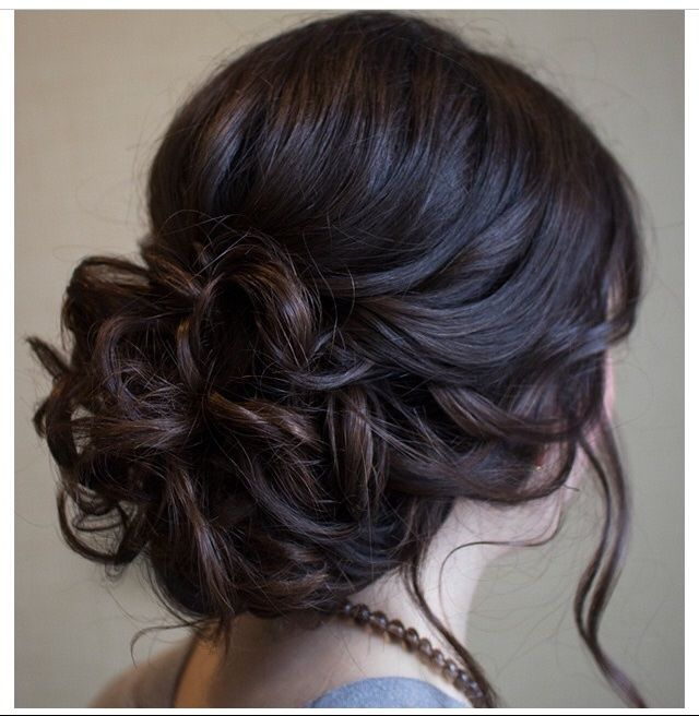 Pretty messy bun with curls
