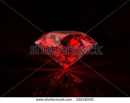 Shiny red diamond on reflective black background