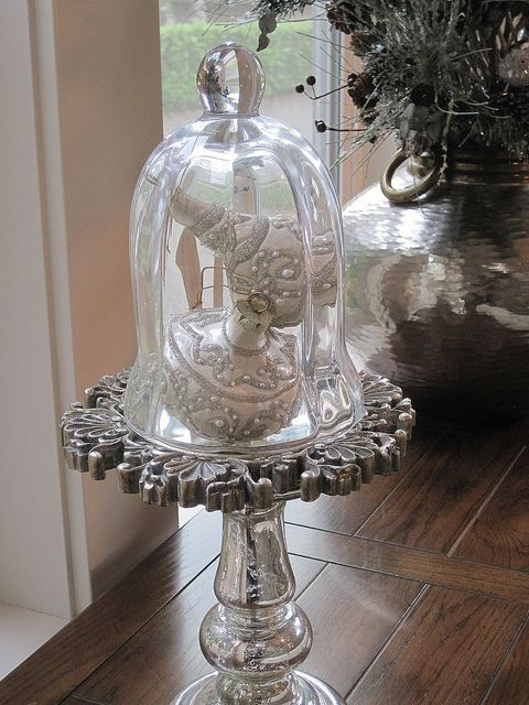 decorating-for-christmas  I had to look close at this beautiful piece....  It's a mercury style candle stick with a decorative mirror topped with a lovely cloche,with two special ornaments tucked in!