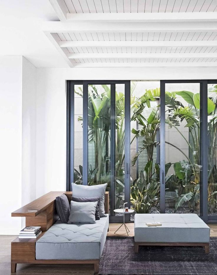 Bright White Walls Provide The Perfect Backdrop For This Low Mid Century Style Grey Furniture Internal CourtyardLiving EtcLiving RoomOpen