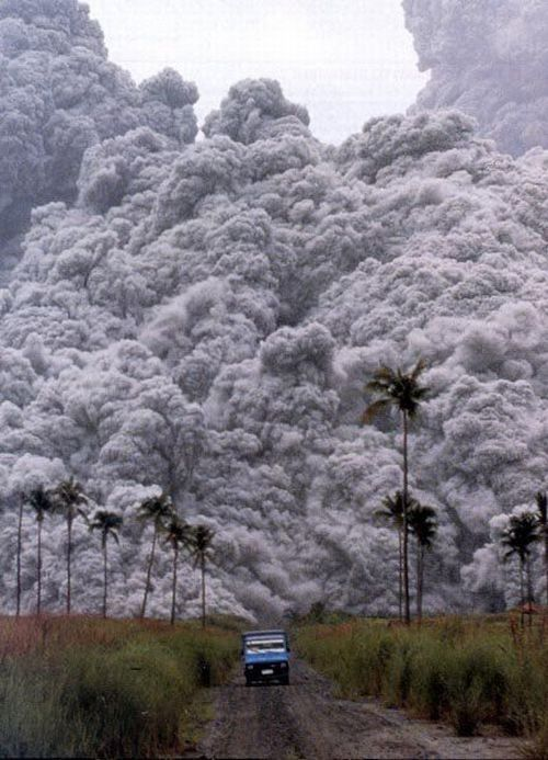 "Pyroclastic flow, Philippines. ""A pyroclastic flow is a fluidized mixture of solid to semi-solid fragments and hot, expanding gases that flows down the flank of a volcanic edifice. These awesome features are heavier-than-air emulsions that move much like a snow avalanche, except that they are fiercely hot, contain toxic gases, and move at phenomenal, hurricane-force speeds, often over 100 km/hour."
