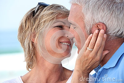 Middle aged couple kissin. by Auremar, via Dreamstime