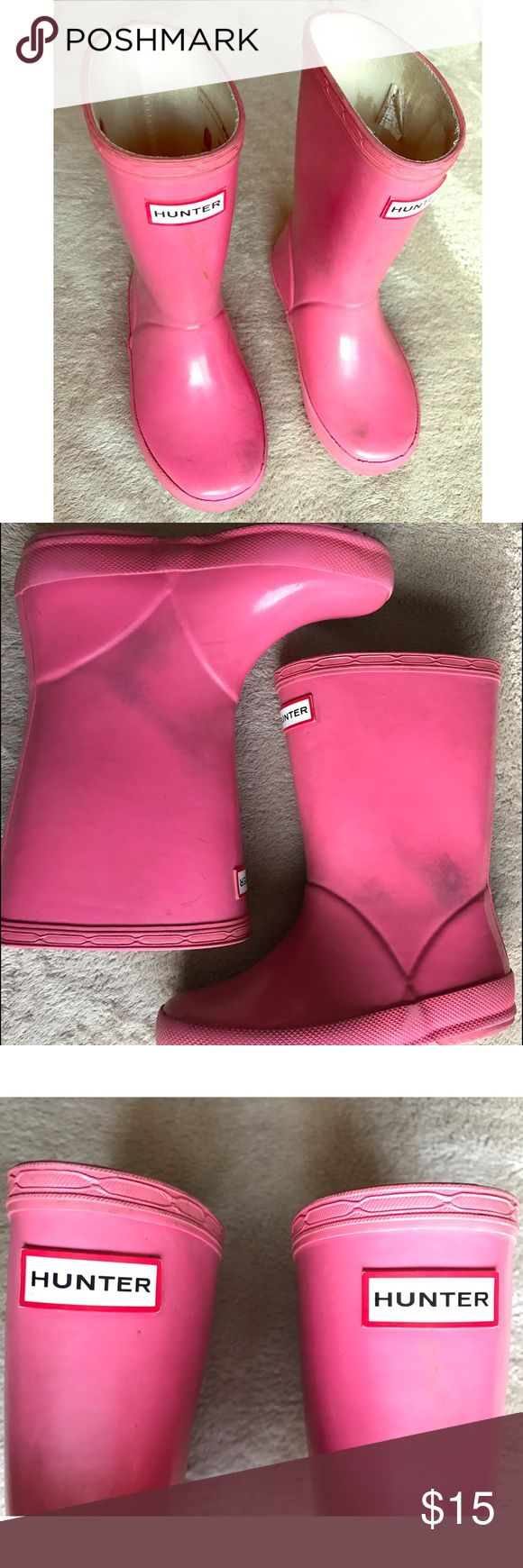 Hot Pink Hunter Rain Boots These Hot Pink Hunter rain boots are the perfect shoe for the rain or running around in the mud. There is stains that I couldn't remove but there is not ripping or scratches. They can still be perfect for the outdoors. Hunter Boots Shoes Rain & Snow Boots