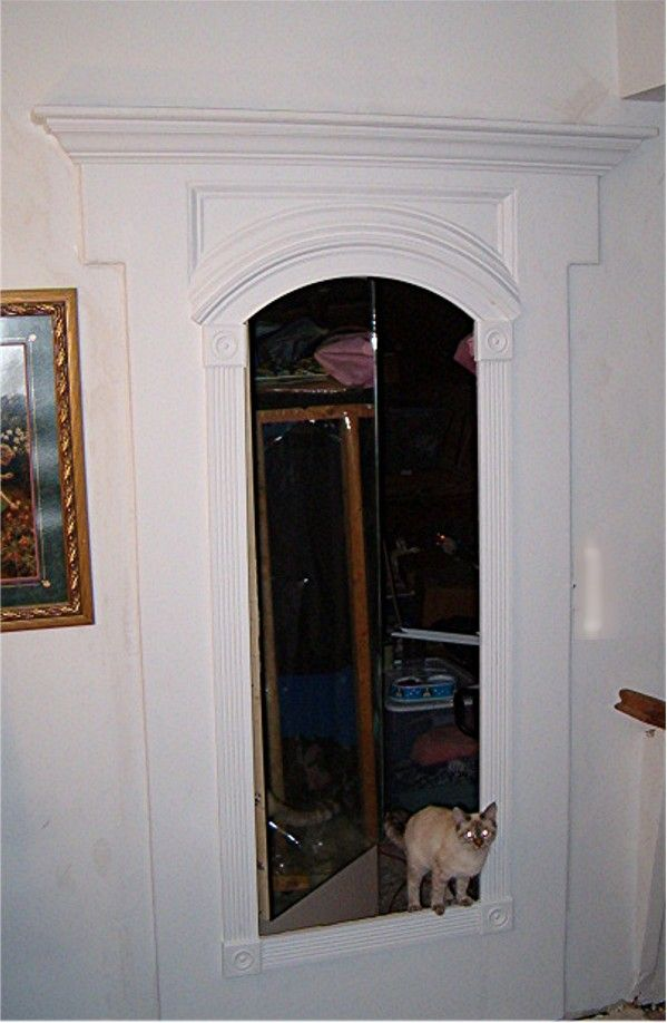 Hidden door behind a mirror...great way to add some