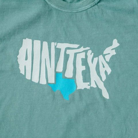 "Our most popular T-shirt that reminds everyone that there are two types of states in America; Texas, and all the rest that ain't Texas. Printed on a seafoam colored Comfort Colors t-shirt. ""The only t"