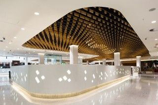 Corian Glacier Ice wall panelling was used, which was back engraved and backlit to create a feature divider wall. The ceiling has been decorated with hand-made lights and wooden pieces, also designed for their calming effect on the acoustics.